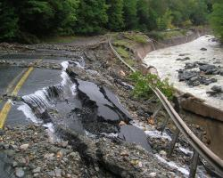 Photo of road destroyed by flood