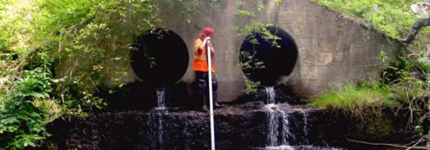Photo of technician measuring culvert